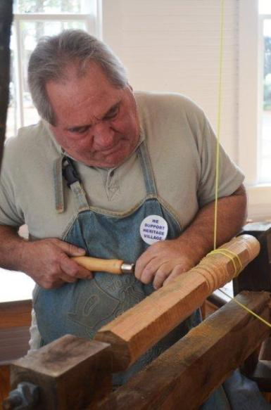 2013's Guild President Dale Neff working on a spring pole lathe